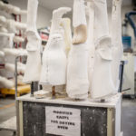 A collection of casts at various stages of adjustment getting ready for the plastic devices to be molded.
