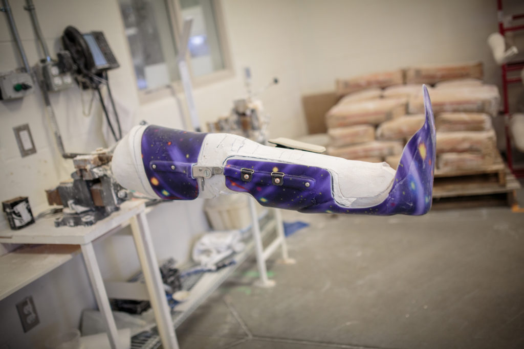 Plastic parts being test fitted on to a plaster cast.