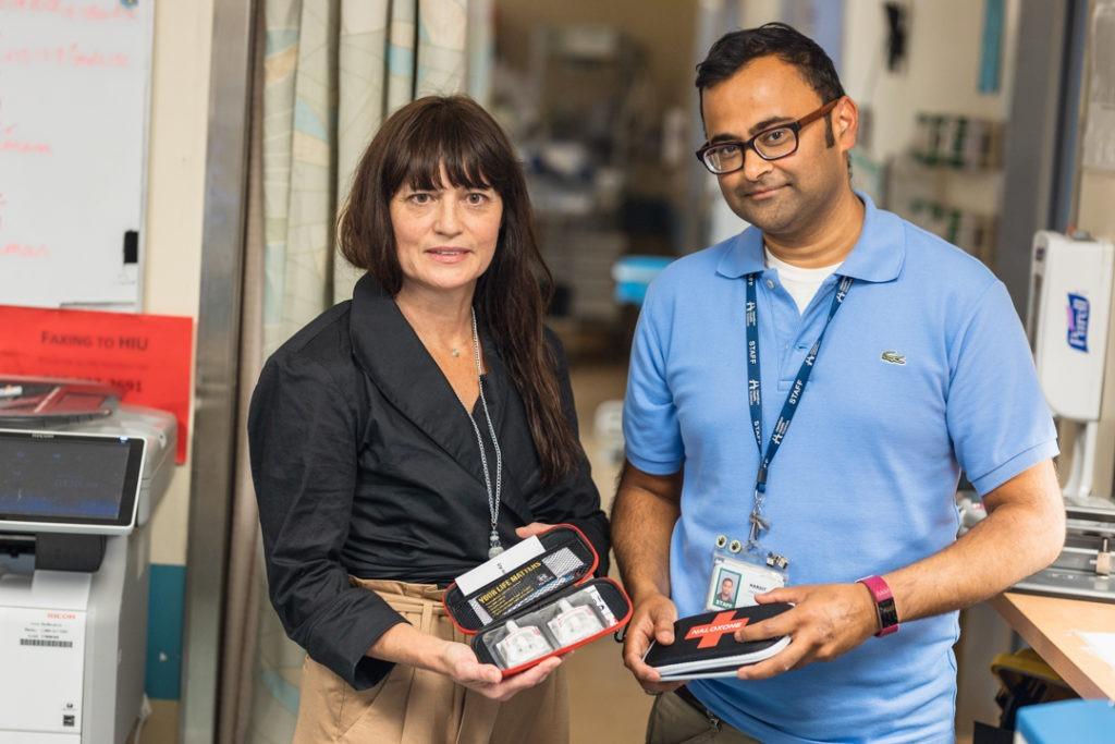 Nancy and Harsit display Naloxone kits