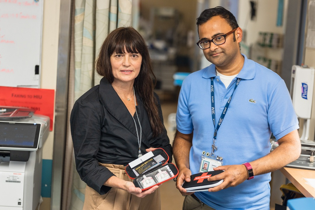 Nancy and Harsit display Naloxone kits