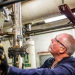 Man working on pressure tests