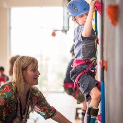 Child climbing indoor climbing wall