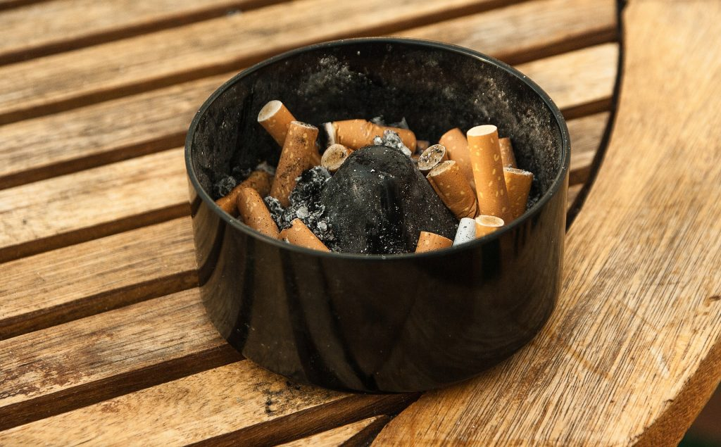 Ashtray with cigarette buds