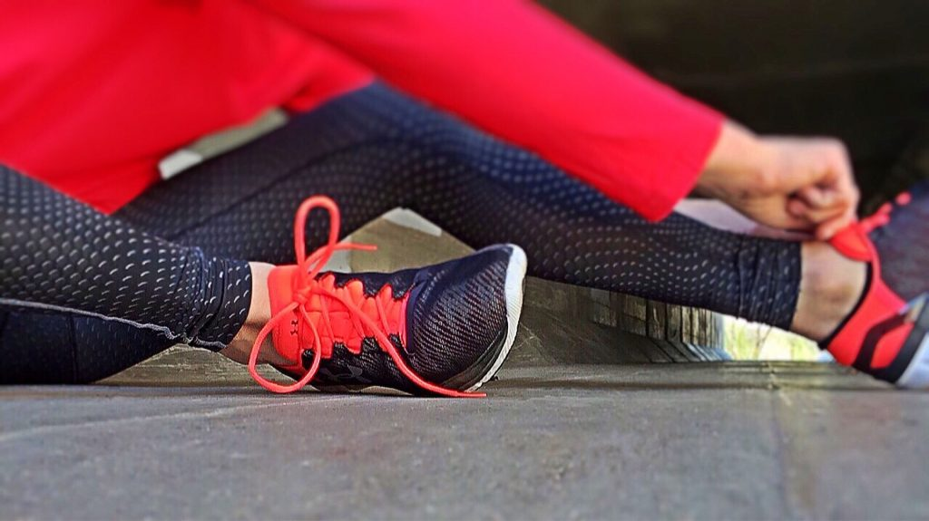 runner tying her shoe