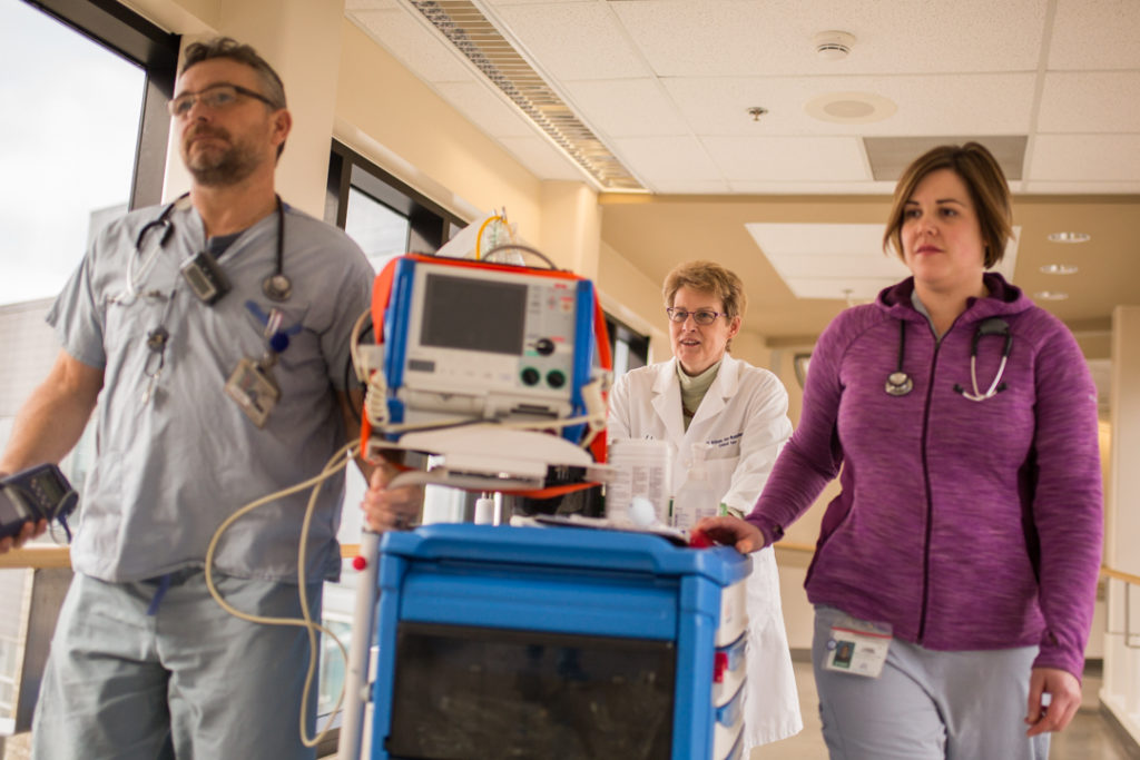 RACE team, including Dr. Fox-Robichaud, in the hallway of the hospital