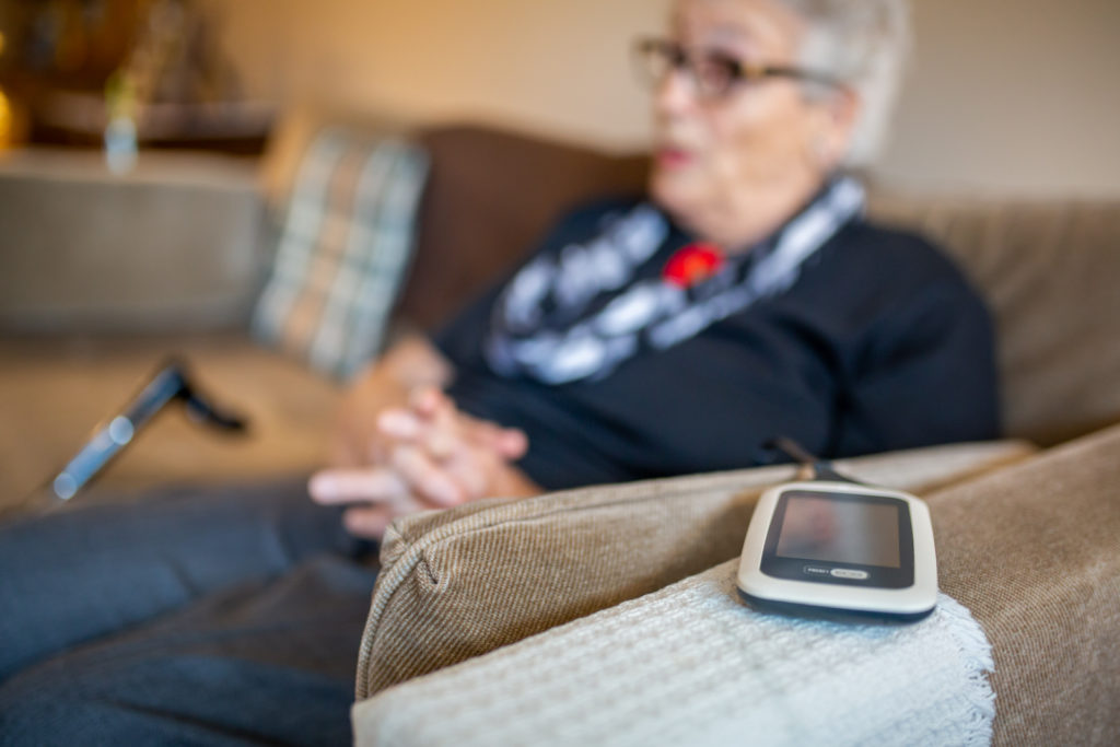 Portable heart monitor on patient while at home