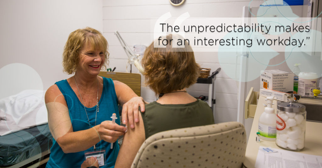 Employee health nurse provides a flu vaccine to an employee in a clinical office