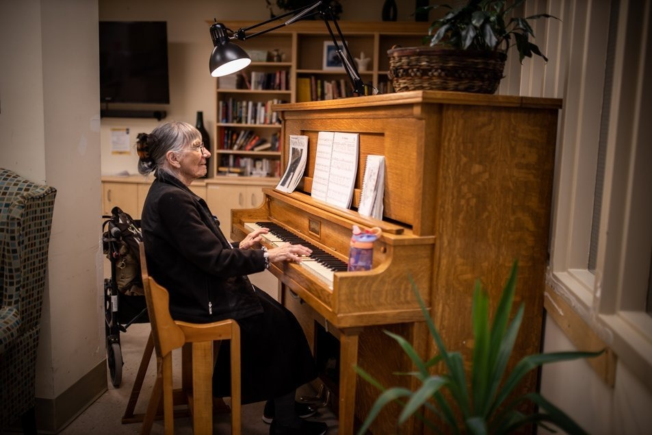 Madeline playing piano as part of the therapeutic recreation programming for patients