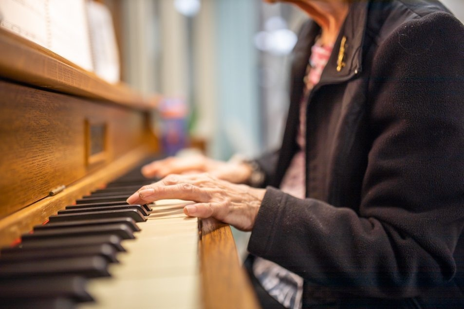 Madeline playing piano for the patients at St. Peter's Hospital