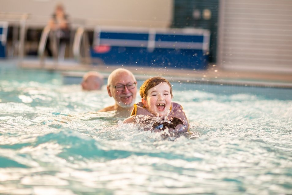 Wesley and his grandfather in the pool