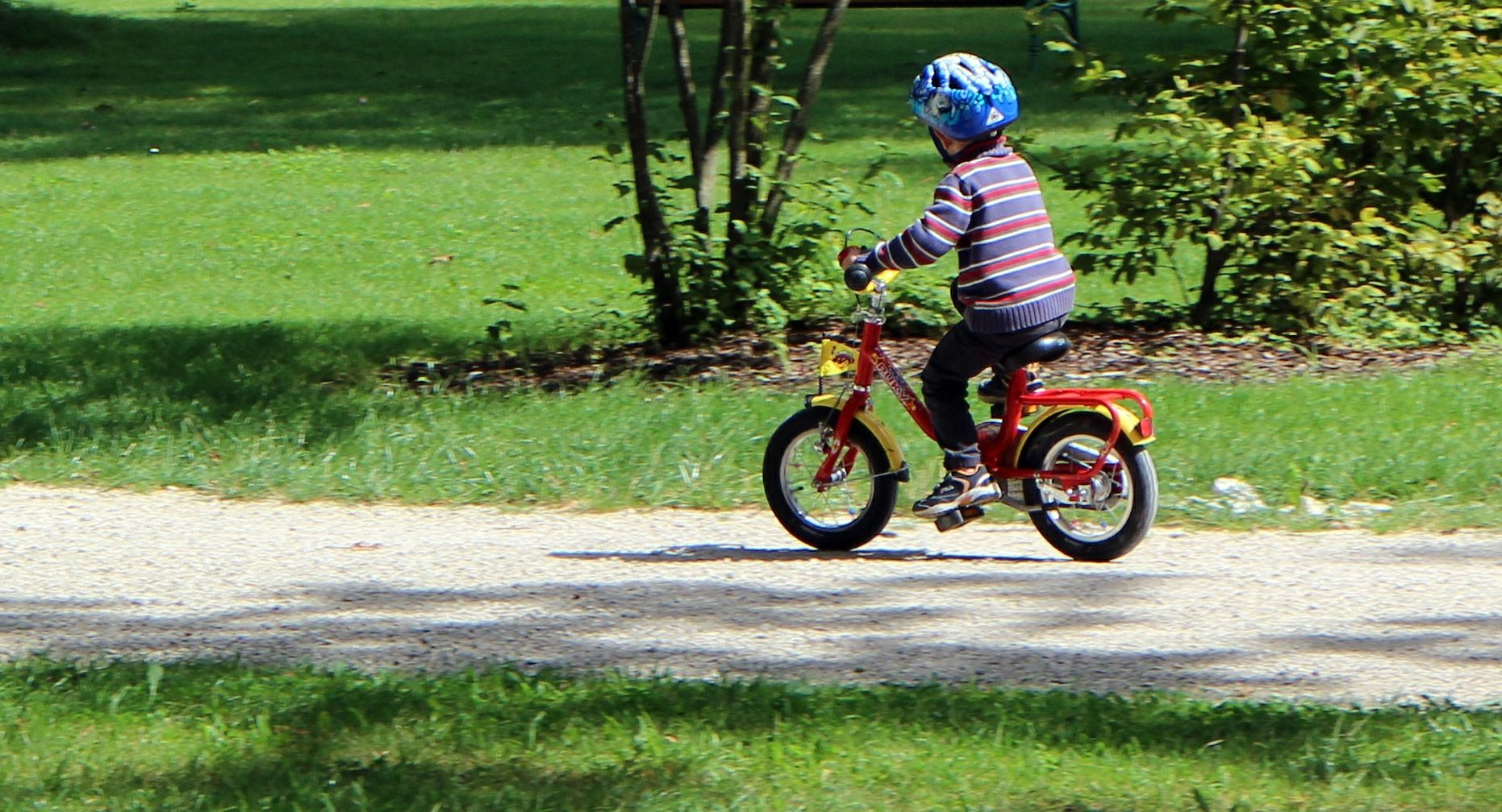 child riding bike with helmet