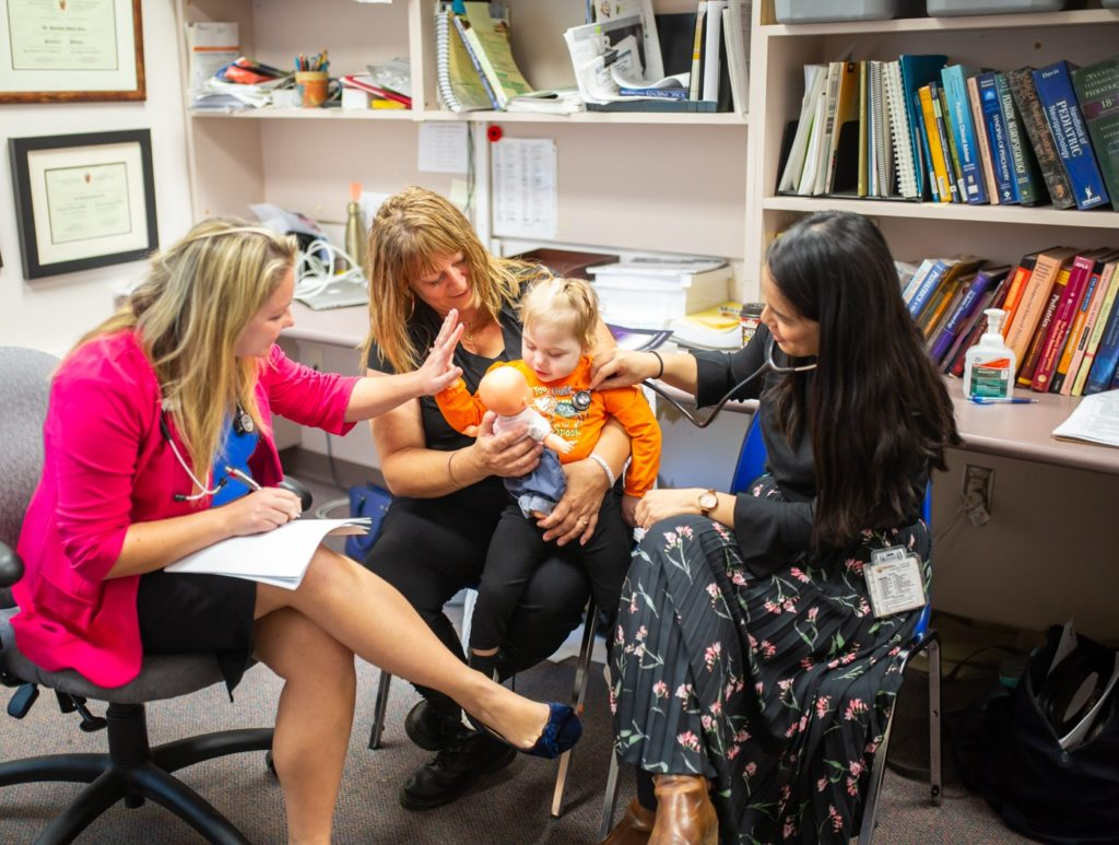 Nurse Practitioner, Anna Polanski, and Dr. Daisy Liu have a check up appointment with Teleah and her grandma, Donna