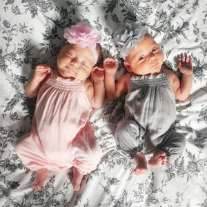 Healthy newborn Mono Mono twins are dressed up