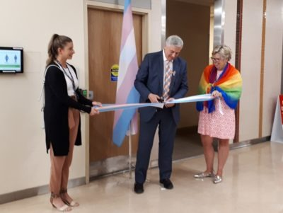 HHS President and CEO, Rob MacIsaac, cuts a ribbon on the new all gender washroom at McMaster University Medical Centre