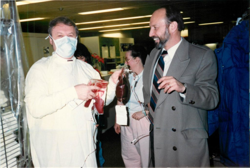 Dr. Irwin Walker arriving from USA with bone marrow. A doctor on the left is holding the stem cell bag.
