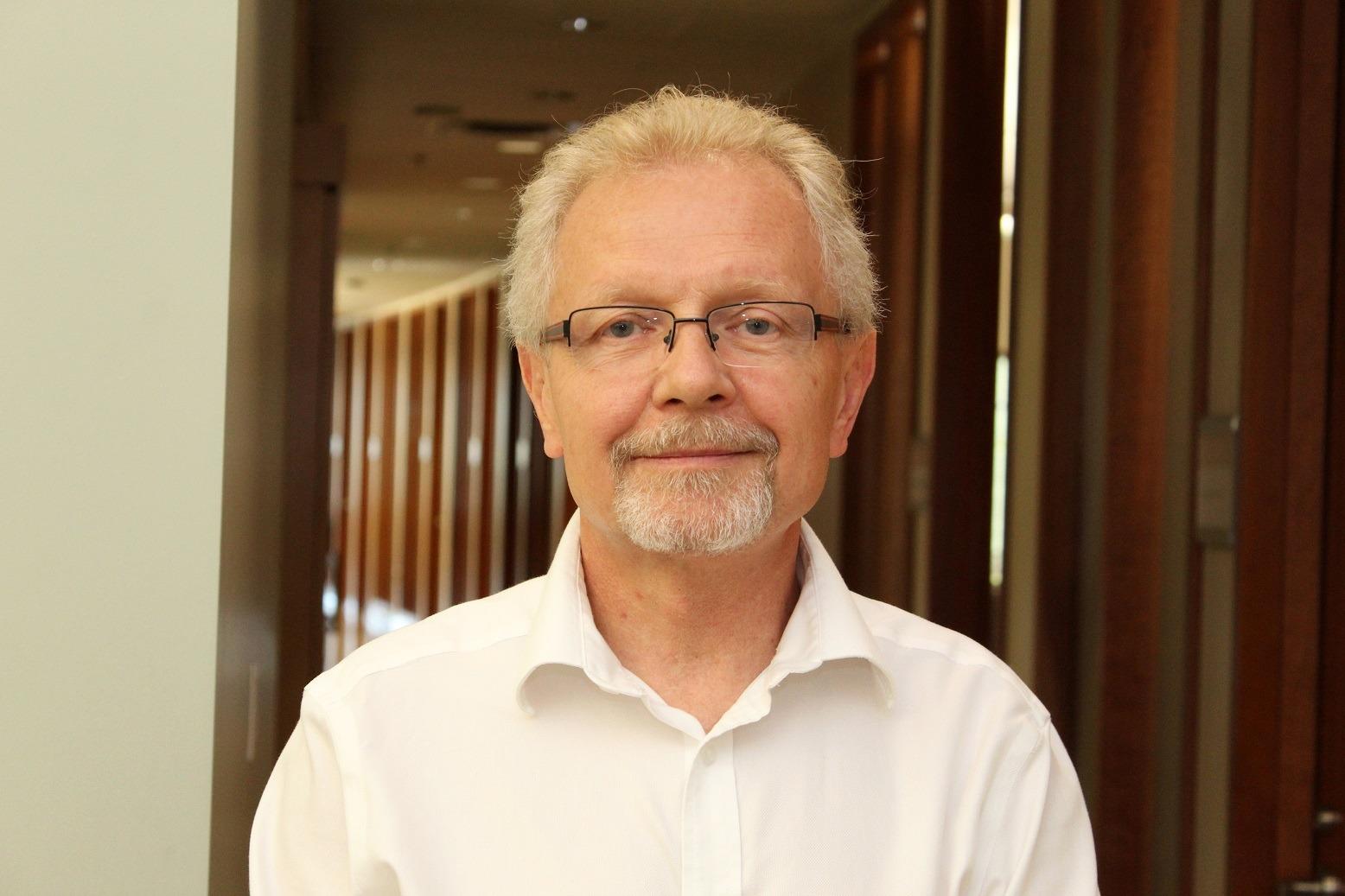 Dr. Wes Oczkowski smiles for a photo