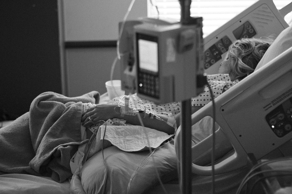 stock photo of woman in hospital bed