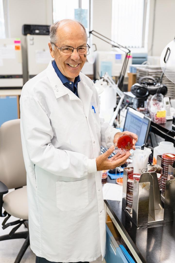 John Korver holds up a specimen plate