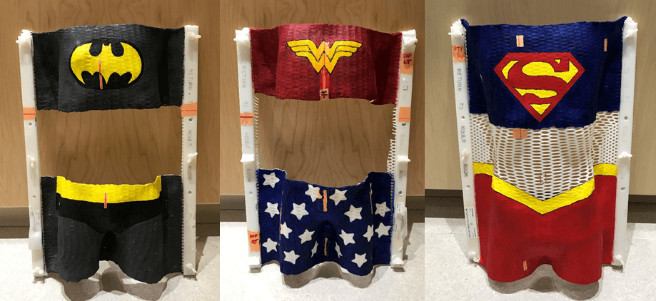 radiation immobilization casts painted like batman, wonder woman and superman
