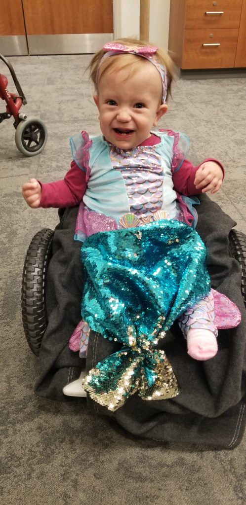 baby girl wearing mermaid costume