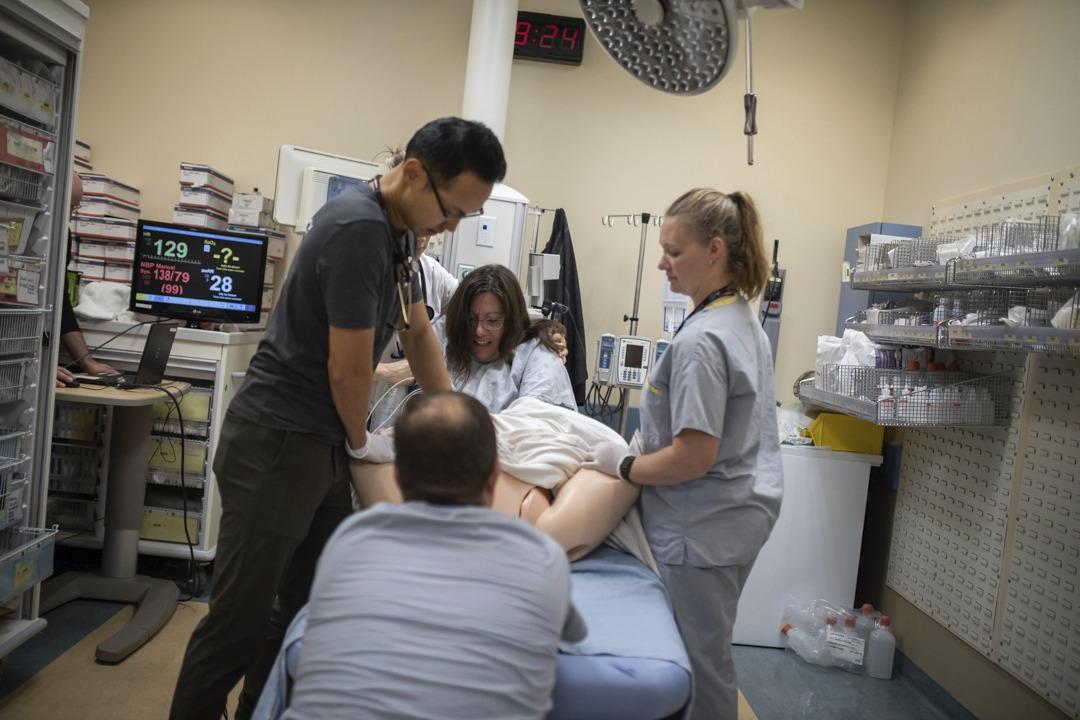 Emergency Birth Simulation - care team surrounding pretend patient giving birth