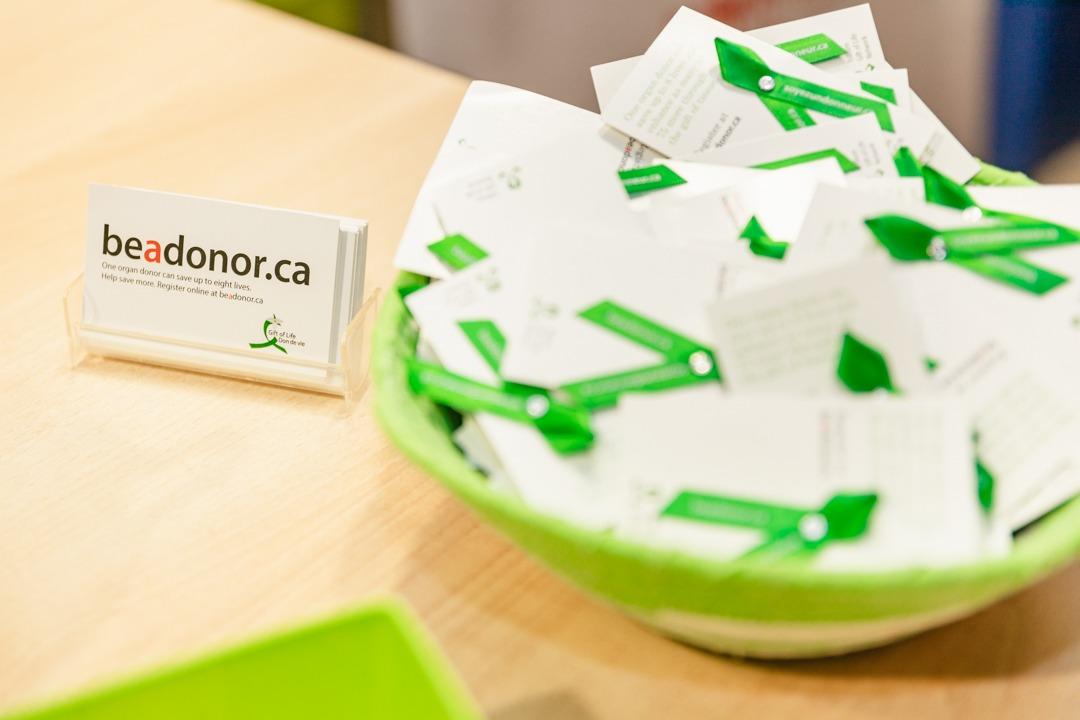 A bowl of green organ donation ribbons