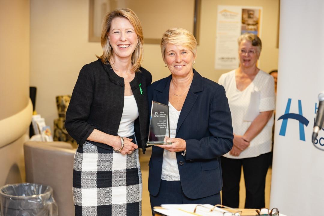 Teresa Smith displays her award