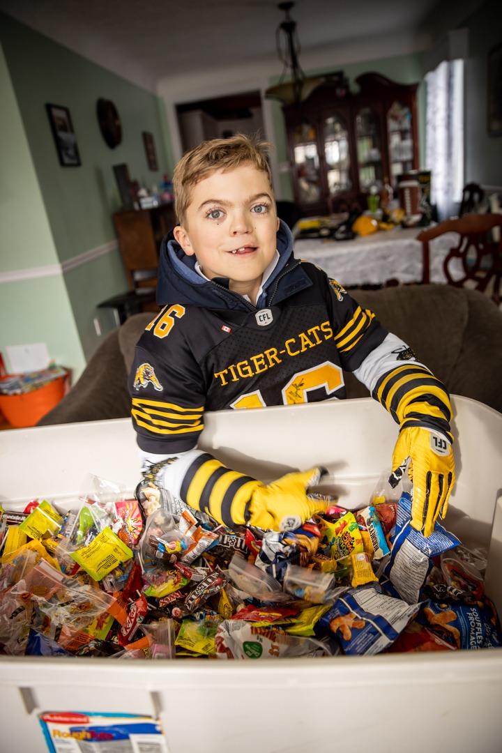 Carter Dery sorts a big bucket of Halloween candy