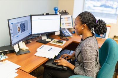 A learning technology specialist at her workstation.