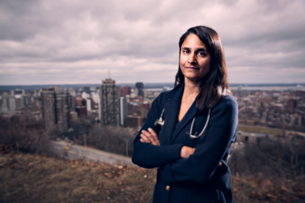 Sonia Anand posing on the edge of the escarpment