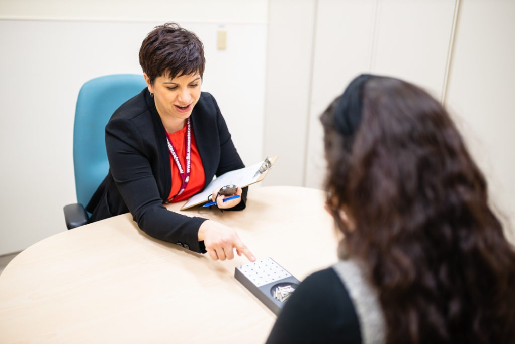A clinical neuropsychologist at work with a patient
