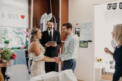 A couple gets married in a hospital room with minister presiding