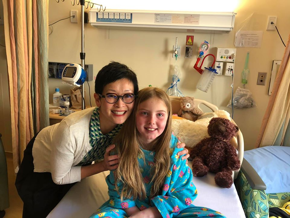 Dr. Choong poses with Savannah in her hospital room