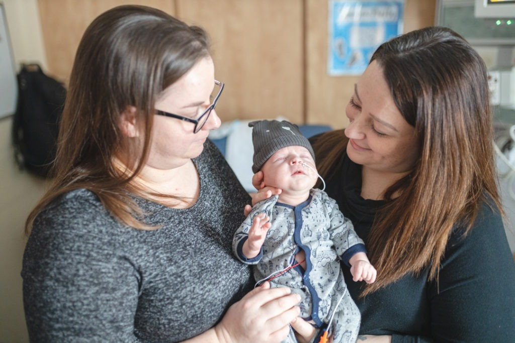 Moms Vanessa and Michelle holding Baby Sawyer