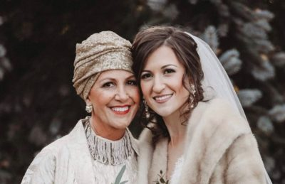 Tracey (left) smiles for a photo with her daughter (right) on her wedding day.