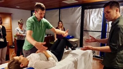 A healthcare worker lies on a `smart bed' while other healthcare workers stand nearby.