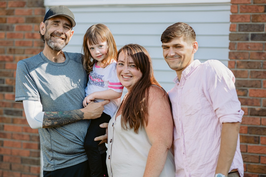 Georgia pictured with her mother, father and grandfather
