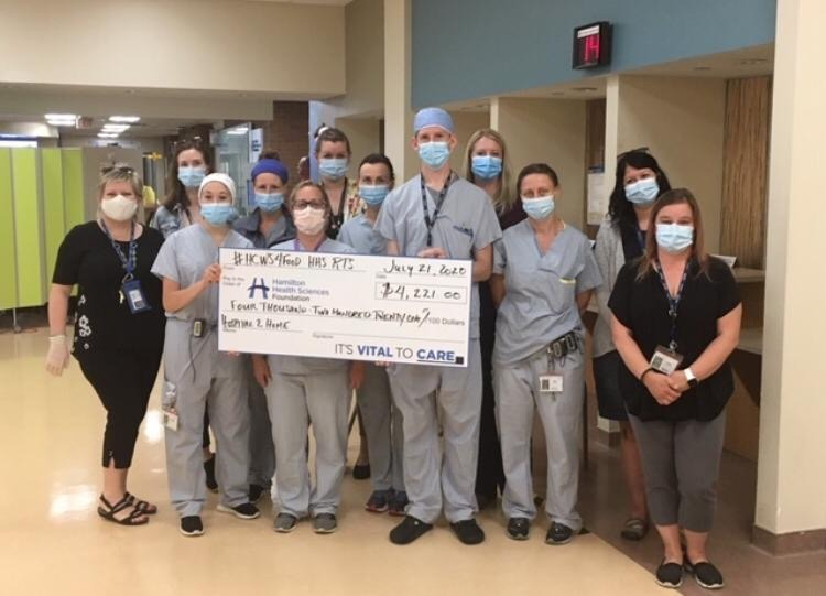 Group of respiratory therapists holding a fundraising cheque