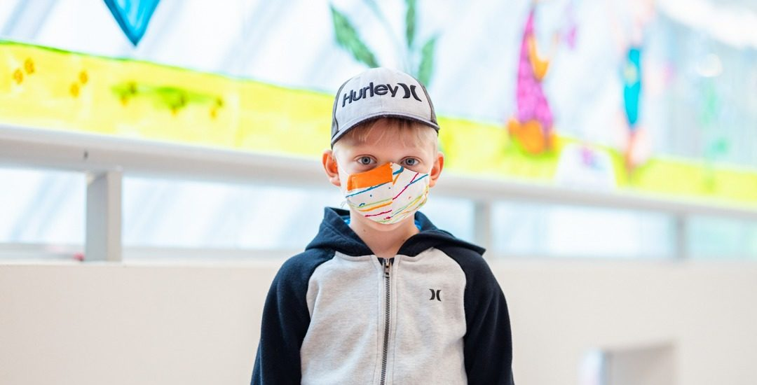 Young boy wearing a mask