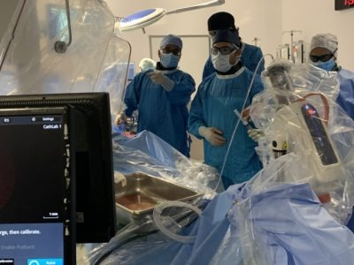 Doctors look at a screen in an operating suite