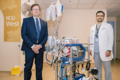 Drs. Andre Lamy and Faizan Amin with an ECMO machine