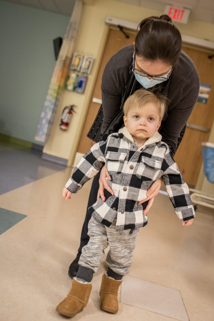 Mom holding Wyatt as he tries to walk