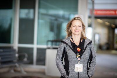 Janet Corning stands outside the Juravinski Hospital and Cancer Centre.