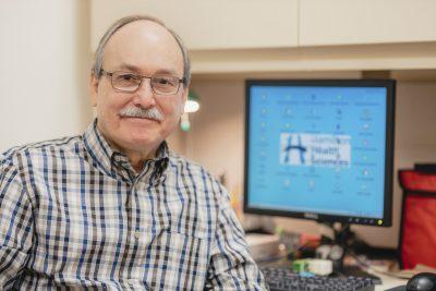 Psycho-Spiritual Practitioner Dave Jones sits at his desk at Hamilton Health Sciences