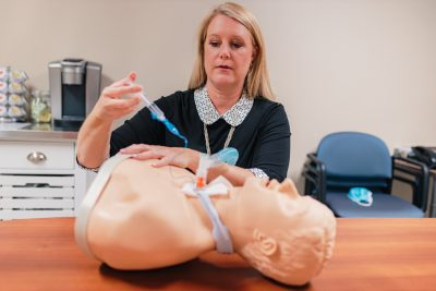 Charge respiratory therapist Claudia Poulin demonstrates teaching using a mannequin