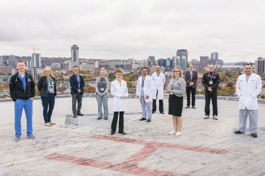 Staff pose with awards received from the Trillium Gift of Life Network on the helipad at Hamilton General Hospital