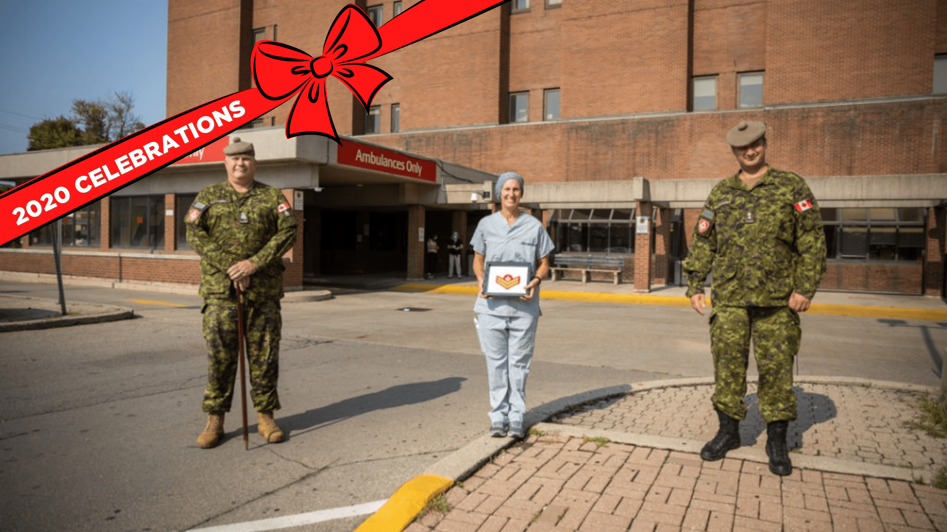 Regimental Sergeant Major, Chief Warrant Officer Grant Lawson (left) and Commanding Officer, Lieutenant Colonel Carlo Tittarelli (right) present HHS nurse Jacqueline Terence with her promotion outside Hamilton General Hospital.
