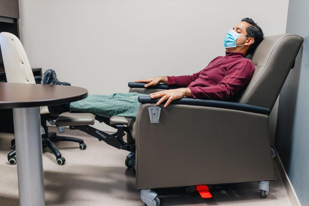 HHS clinical pharmacist Vikas Parihar rests in a chair