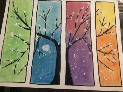 Oil pastel artwork of a tree with a colourful collage background. Green, blue, purple, pink, yellow and orange.