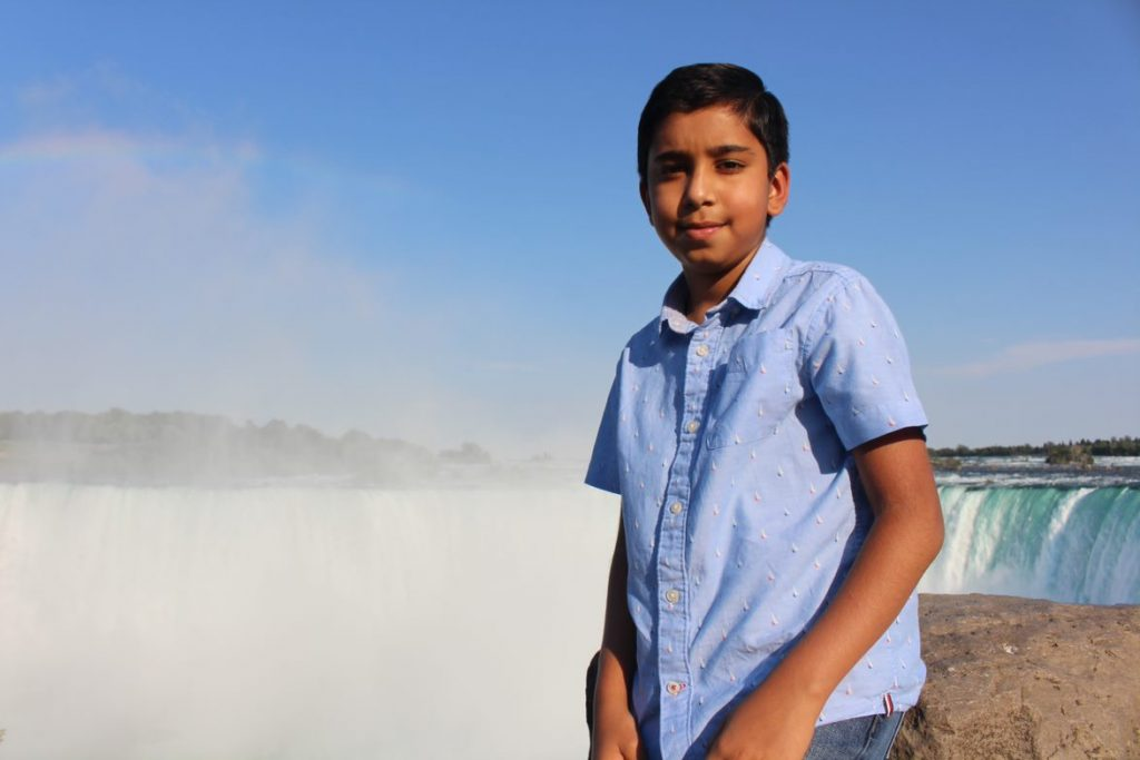 Daanish Kherani stands in front of Niagara Falls